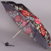 Зонт с яркими цветами на черном куполе Trust 42375